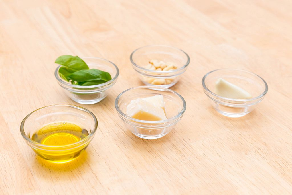 Pesto ingredients: olive oil, Parmesan, garlic, pine nuts and basil