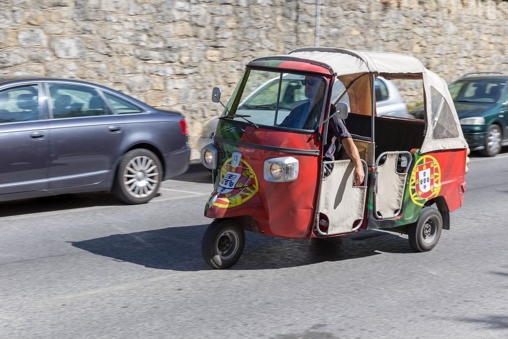 Piaggio Tuk Tuk painted with the flag of Portugal