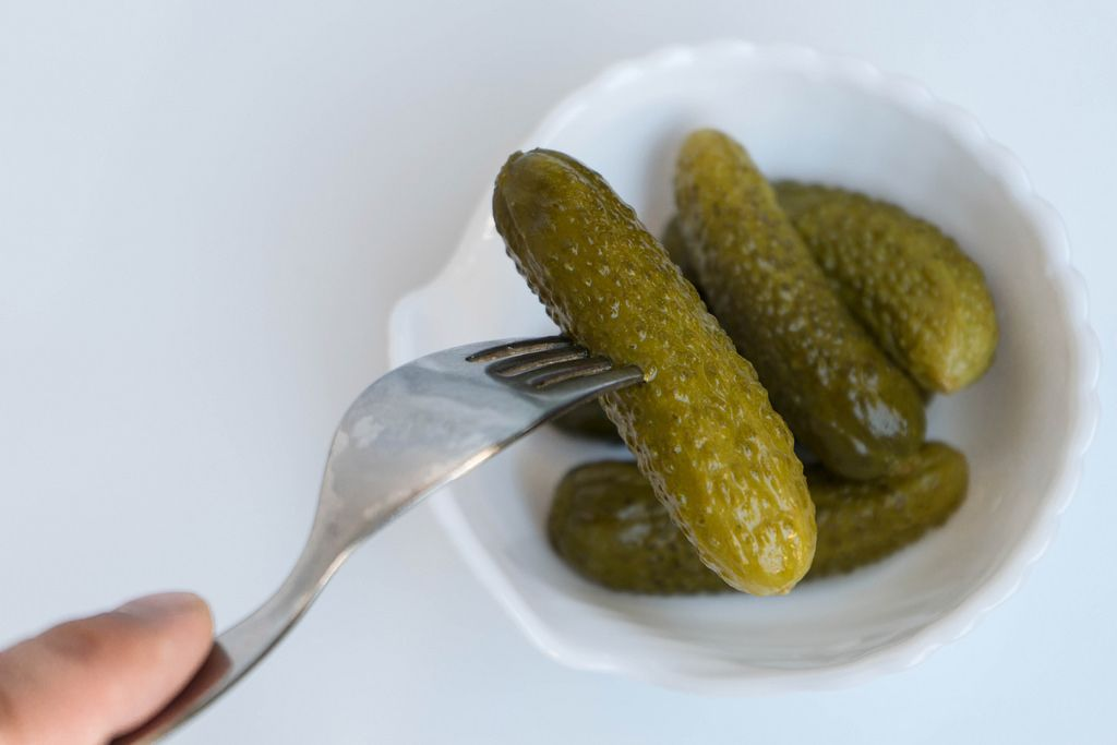 Pickled Cucumber Pricked on the Steel Fork