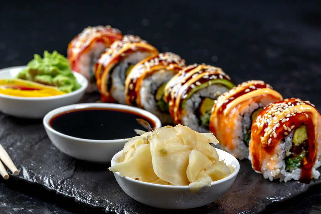 Pickled ginger, soy sauce, wasabi and sushi rainbow Dragon