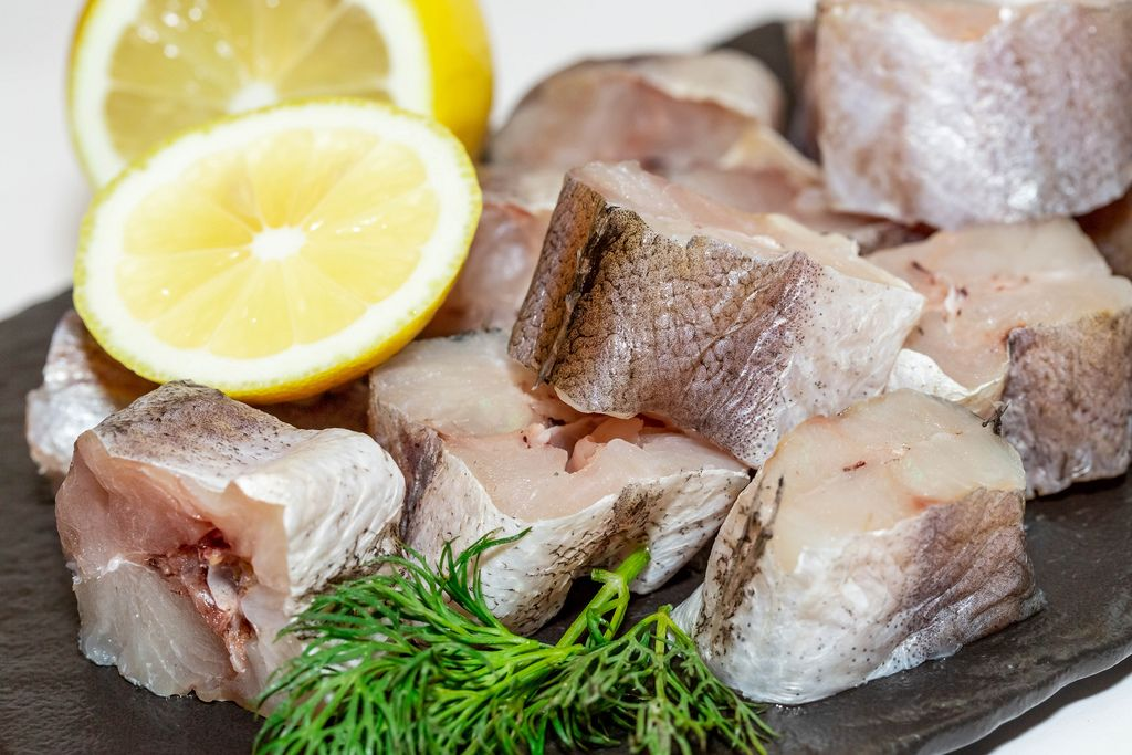 Pieces of raw fish hake with herbs and lemon (Flip 2019) (Flip 2019) Flip 2019