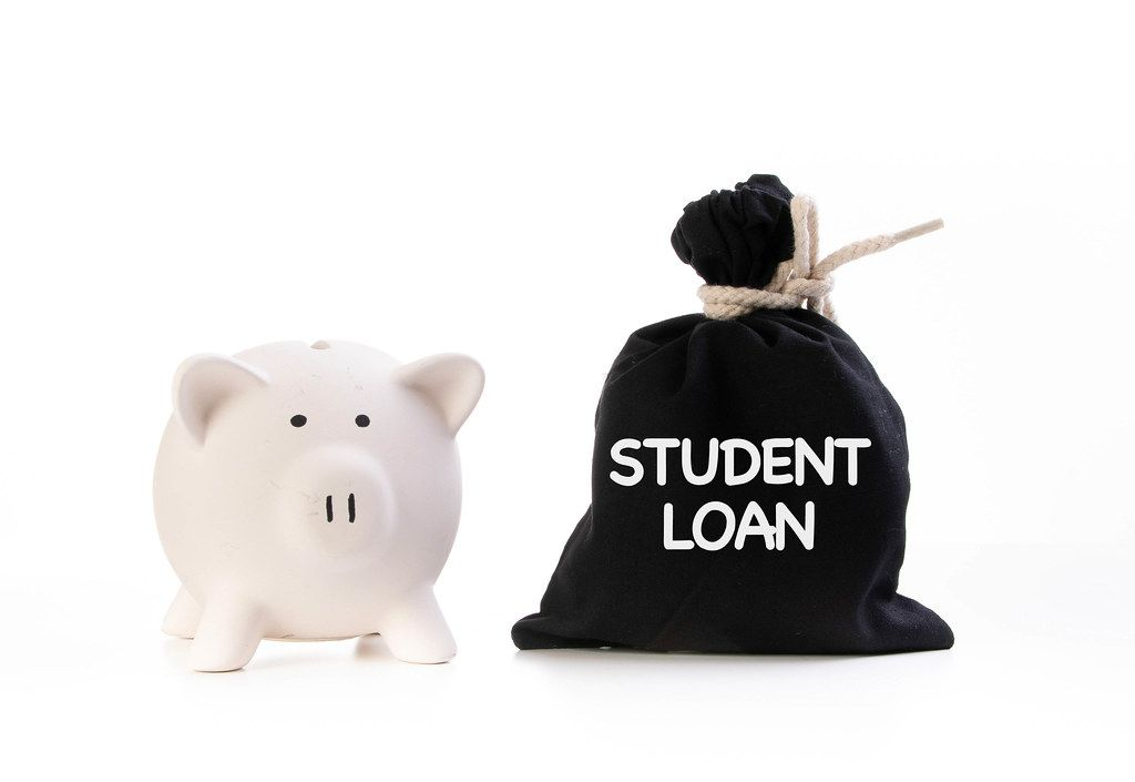 Piggy bank and money bag with Student loan text on white background
