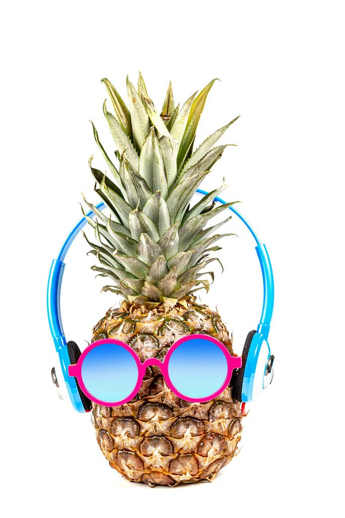 Pineapple wearing sunglasses and headphones. Concept of summer vacation, recreation (Flip 2020)
