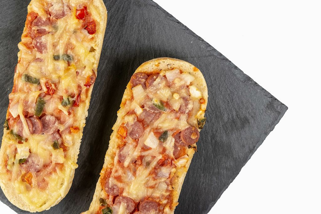 Pizza Baguette on the black stone tray (Flip 2019)
