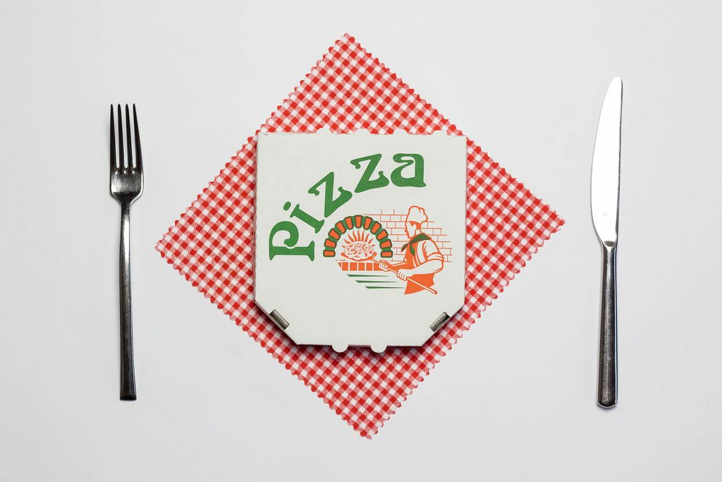 Pizza box with fork and knife