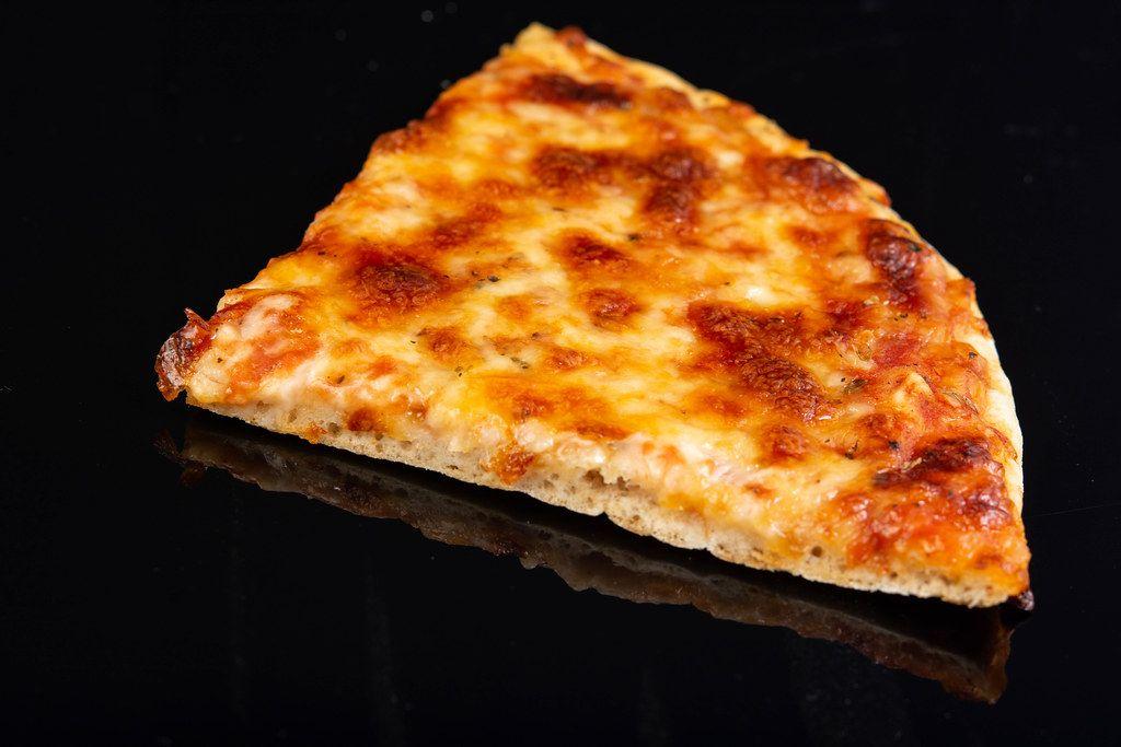 Pizza Margarita slice on the black background