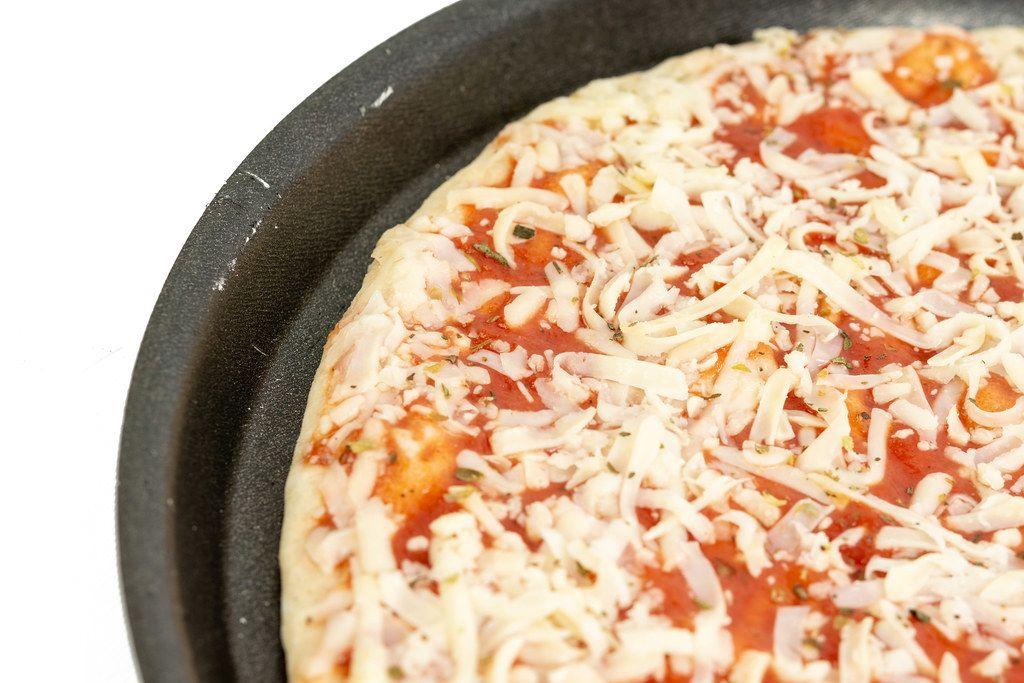 Pizza Margharita prepared for baking