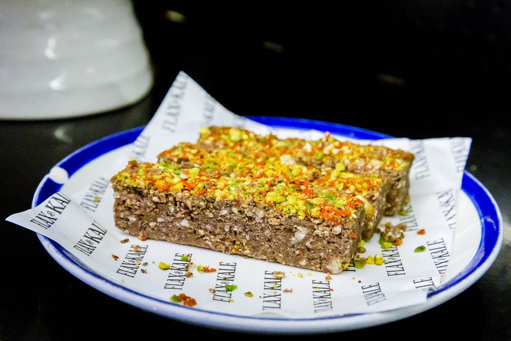 Plant-based Energy Spice Bar at Flax&Kale in Barcelona with almonds, walnuts, cocoa, cayenne, pistachios, goji berries, chia & sesame