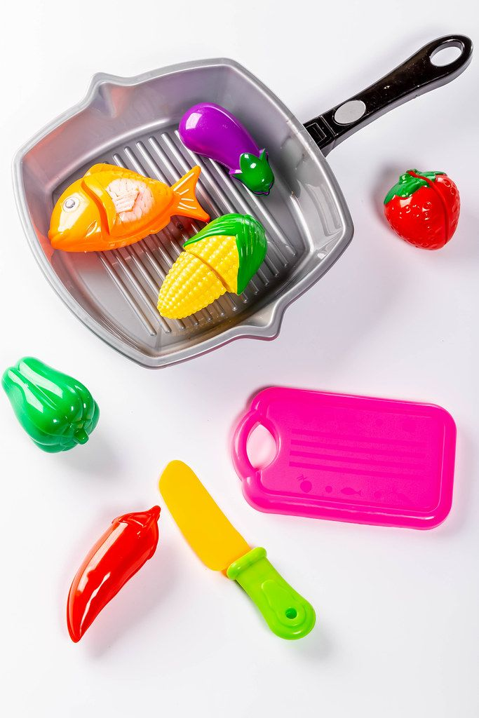 Plastic children's toys vegetables, frying pan, knife and tray
