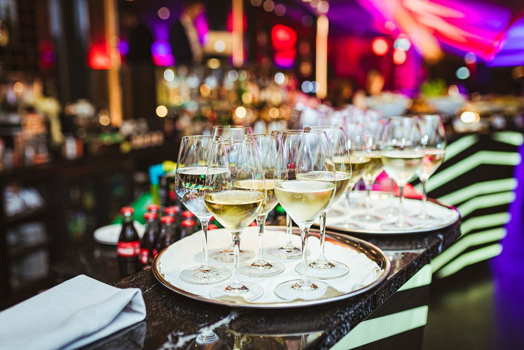 Plate Of White Wine In Restaurant Lights
