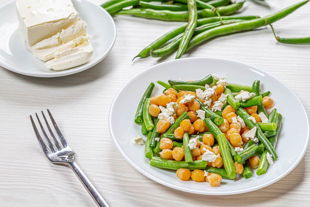 Plate with diet salad with chickpeas, asparagus and feta cheese. Healthy eating concept (Flip 2019)