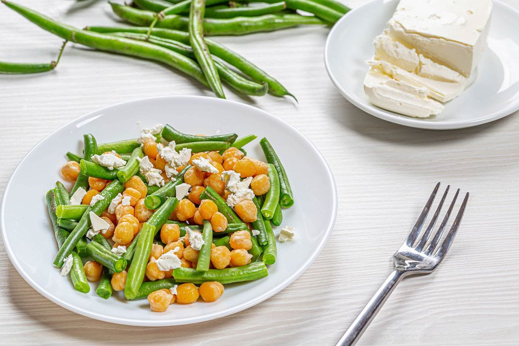 Plate with diet salad with chickpeas, asparagus and feta cheese. Healthy eating concept