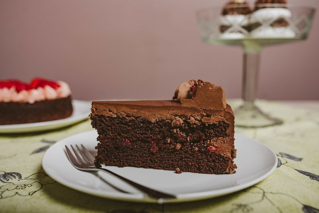 Plate with slice of tasty homemade chocolate cake (Flip 2019)