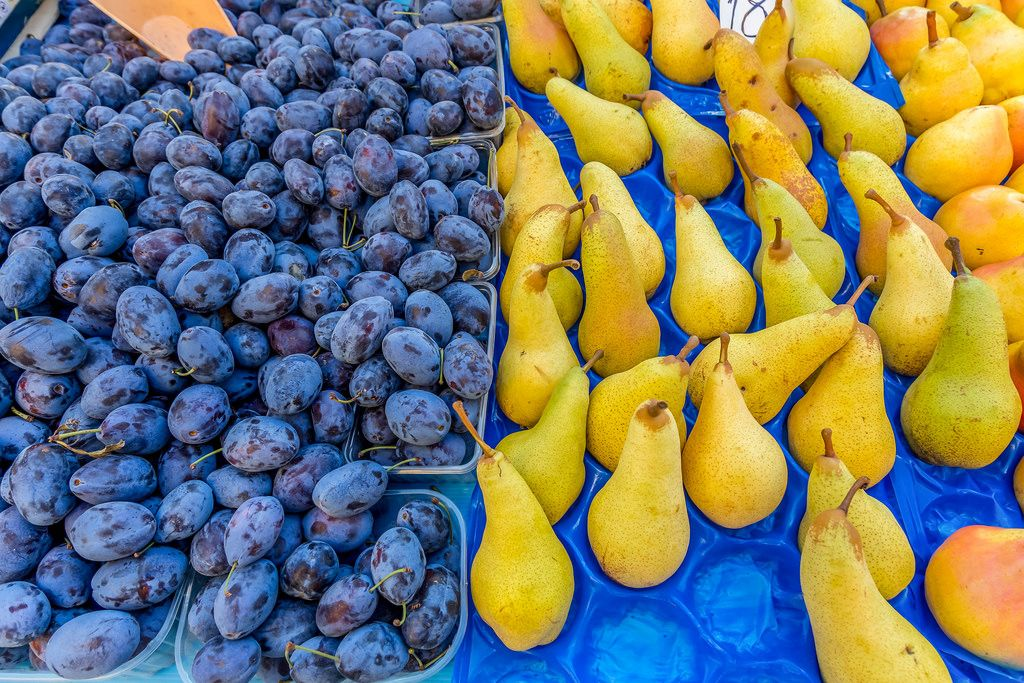 Plums and pears on marketplace