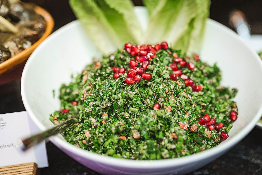 Pomegranate Salad with Mint Fresh Leaves in Glass Bowl (Flip 2019)