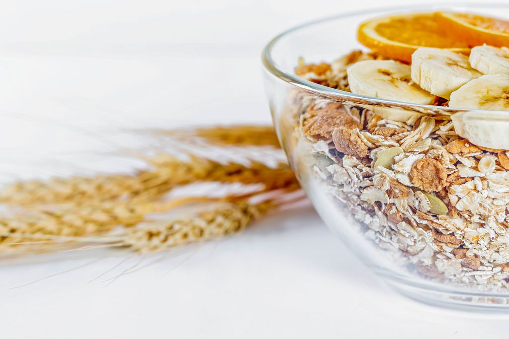 Porridge with cereals of different cereals in a glass plate with wheat spikelets