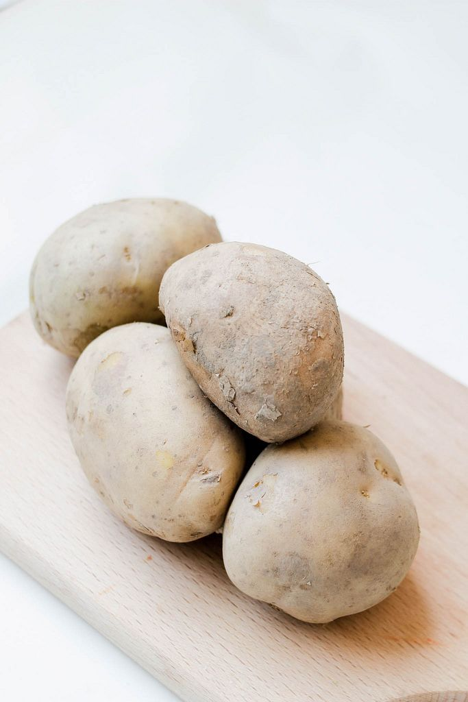 Potatoes on wooden board