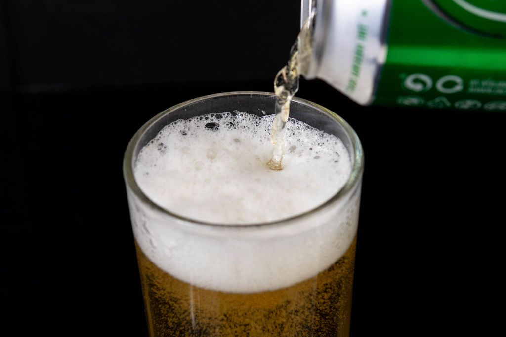 Pouring Heineken Canned Beer in the glass (Flip 2019) (Flip 2019)