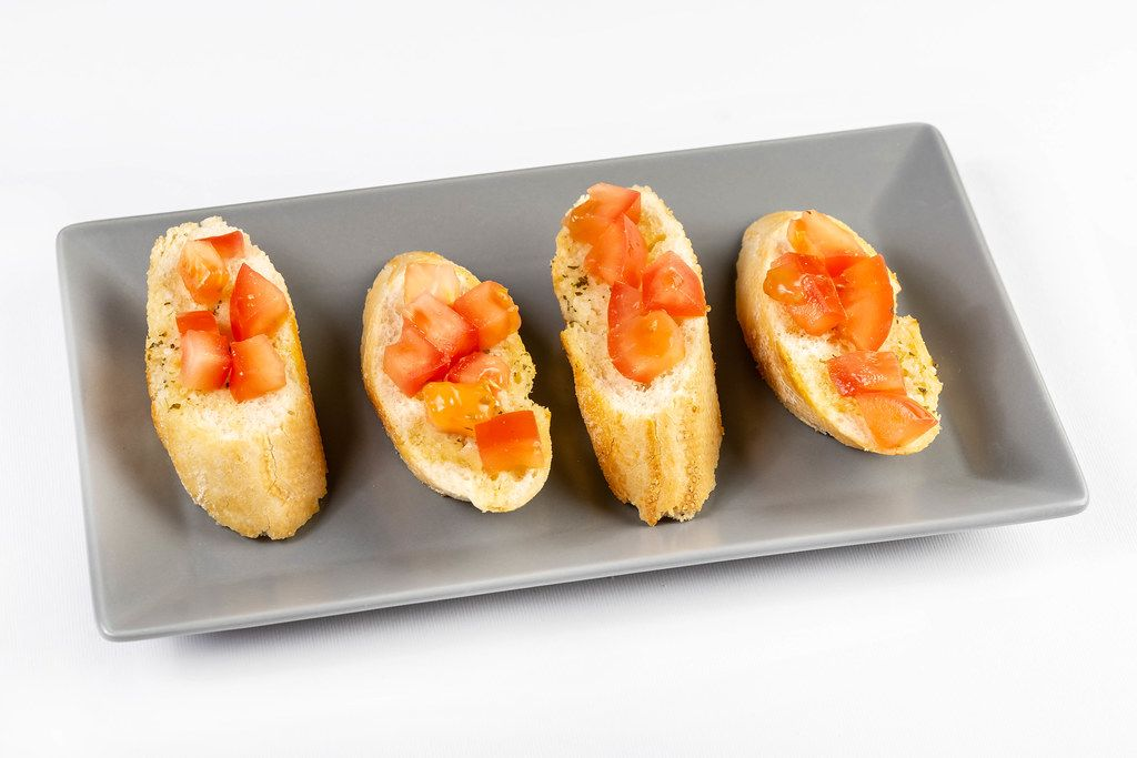 Prepared and served Bread Baguettes with Tomato and Tartar Sauce