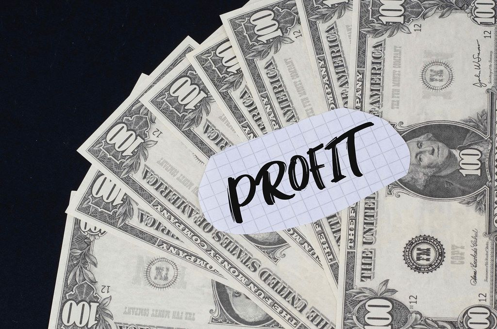 Profit text and dollar banknotes