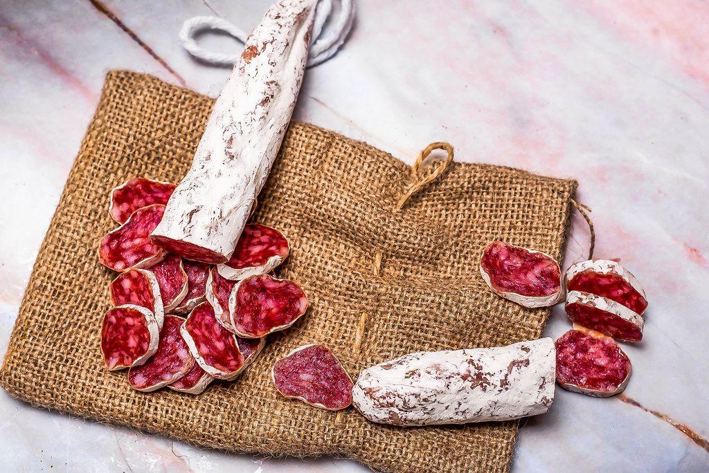 Prosciutto pieces on linen cloth