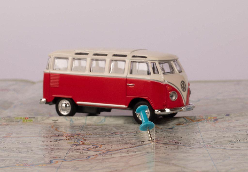Pushpin with vintage camper van on map (Flip 2019)