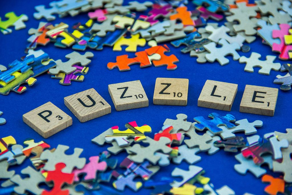 Puzzle Word Surrounded by Pieces