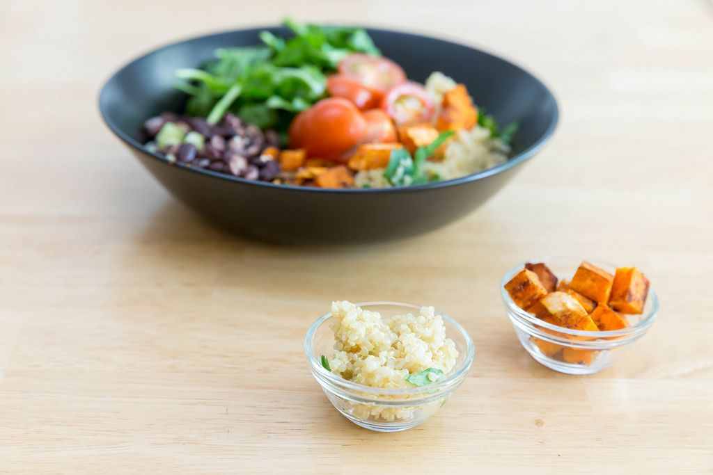Quinoa and roasted sweet potatoes in tiny glass bowls
