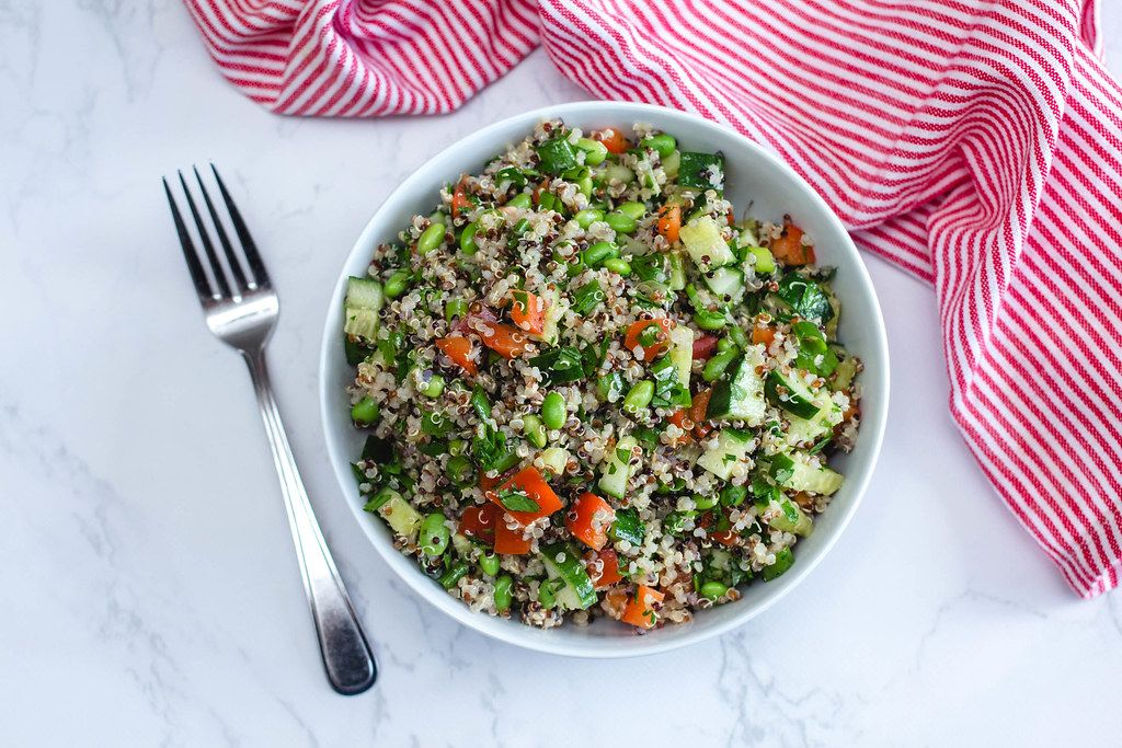 Quinoa Salad with Cucmber, Tomato and Edamame in a White Bowl  (Flip 2019)