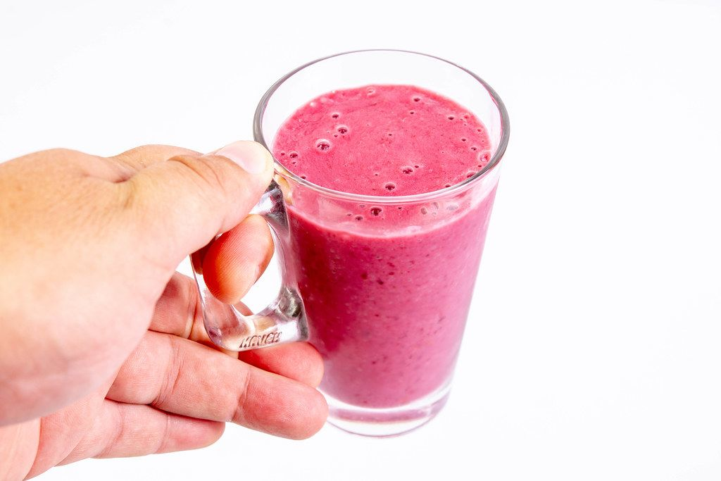 Raspberry Banana and Blackberry Smoothie in the hand