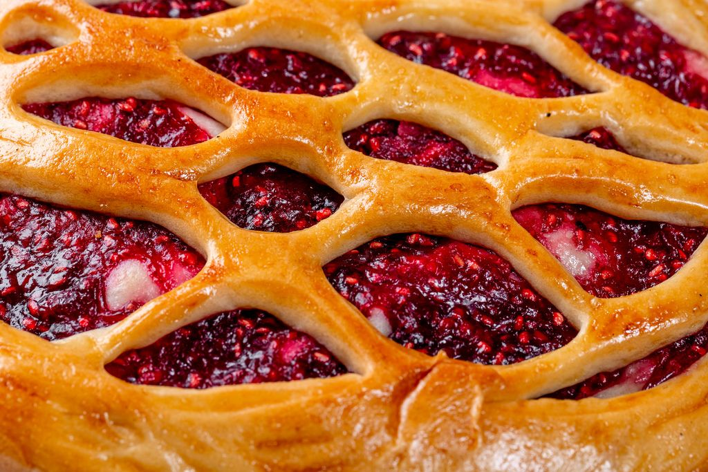 Raspberry pie with raspberry jam close up