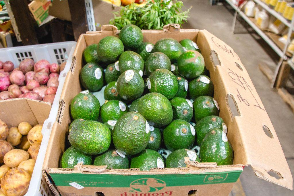 Raw Avocado in a box at the market  (Flip 2019)