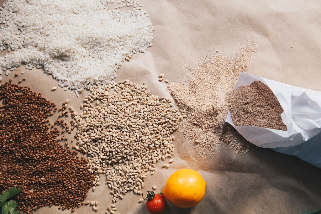 Raw cereals, buckwheat, barley, rice on paper background