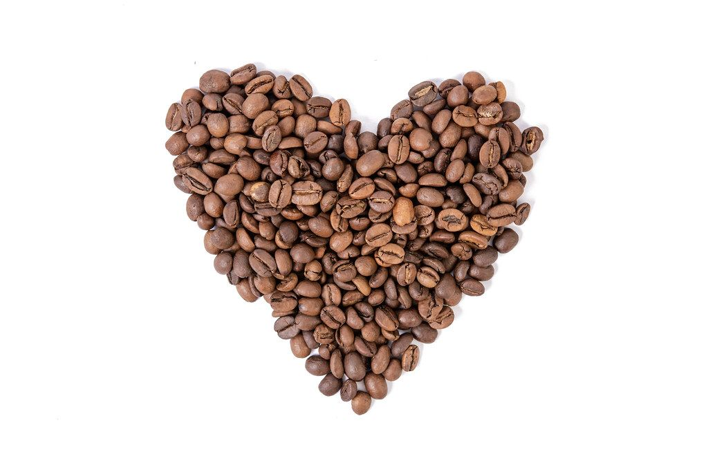 Raw Coffee Heart shape above white background (Flip 2019)