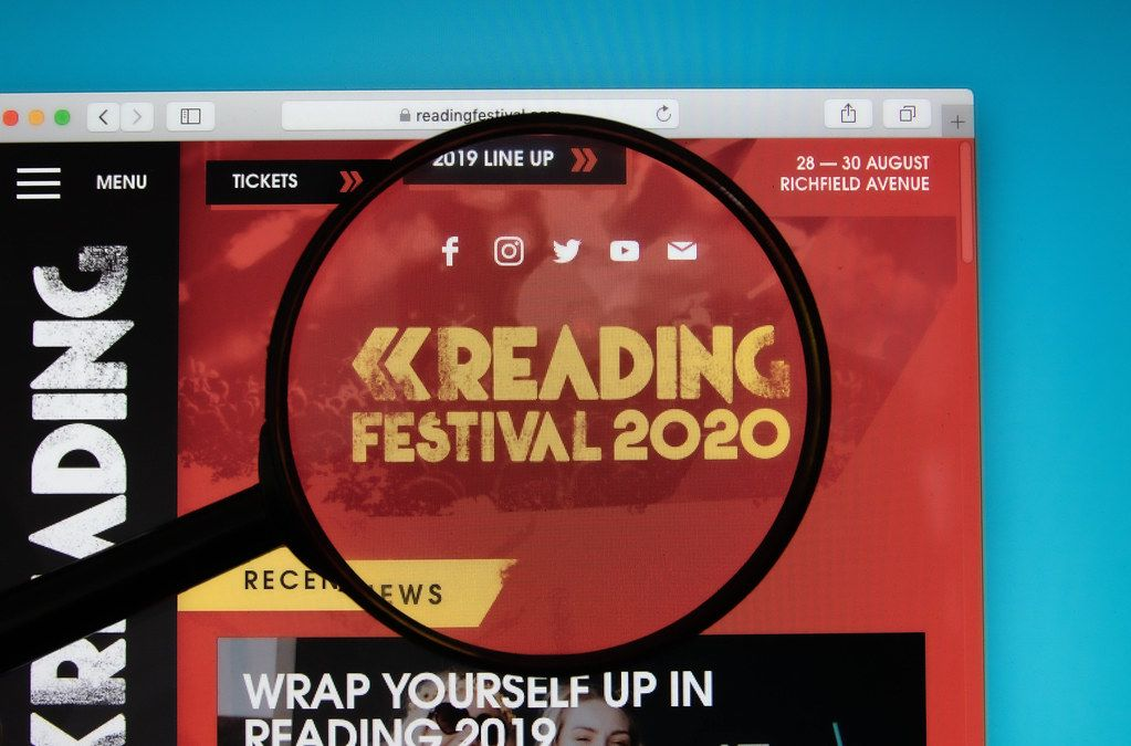 Reading Festival logo on a computer screen with a magnifying glass