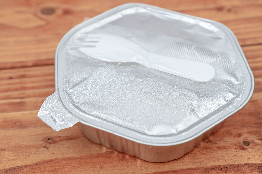 Ready Meal box with plastic fork above wooden table