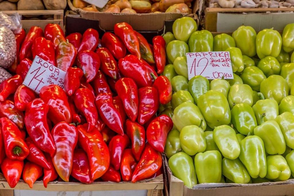 Red and green paprikas on marketplace