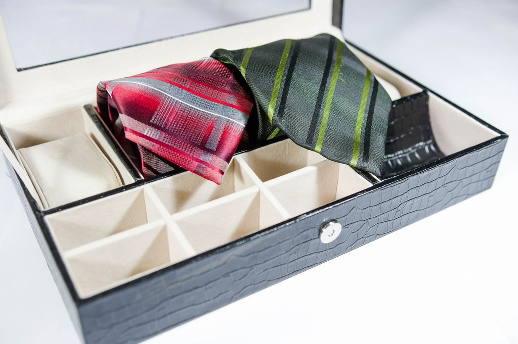 Red and green ties in a small box organizer