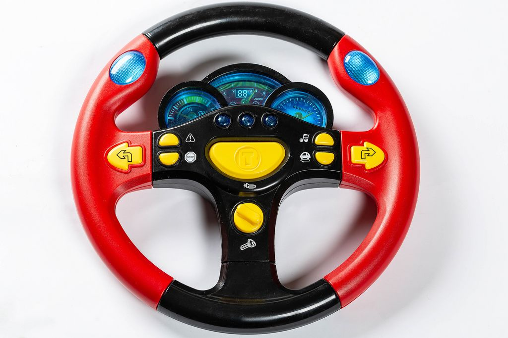 Red-black steering wheel toy