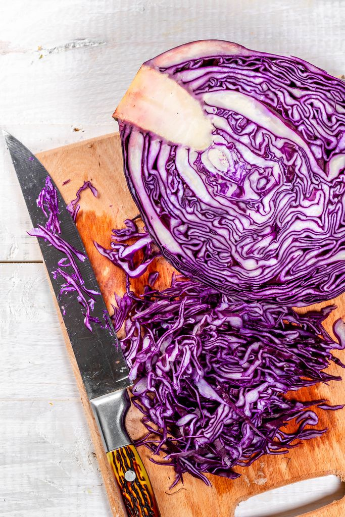 Red cabbage sliced on a kitchen Board with a knife