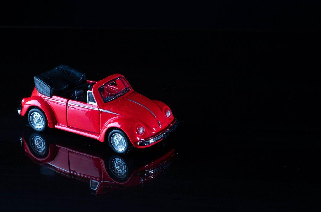 Red cabriolet car on black background (Flip 2019)