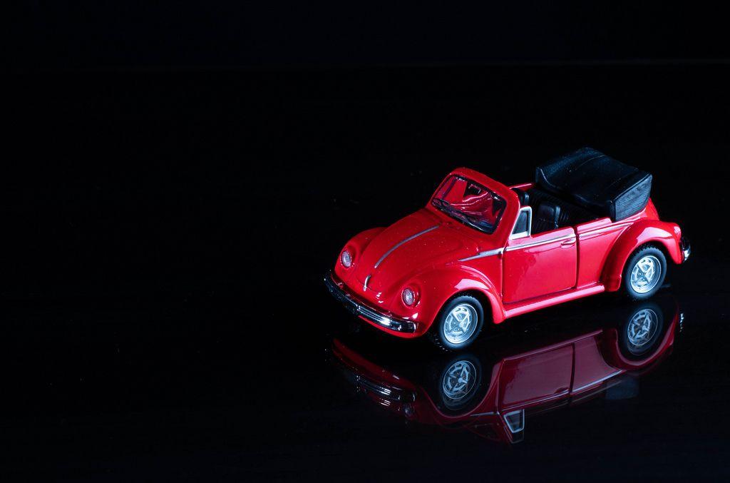 Red cabriolet car on black background