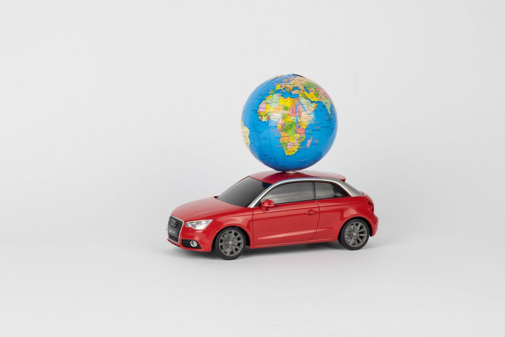Red car with a world globe