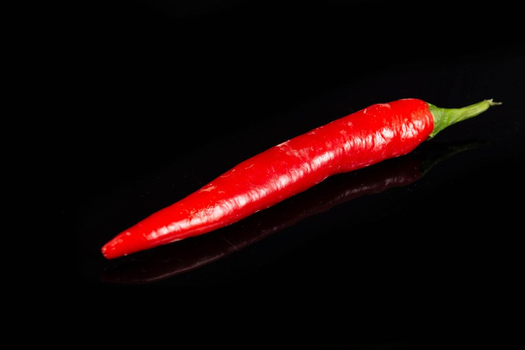 Red Chilli Hot Pepper above black background