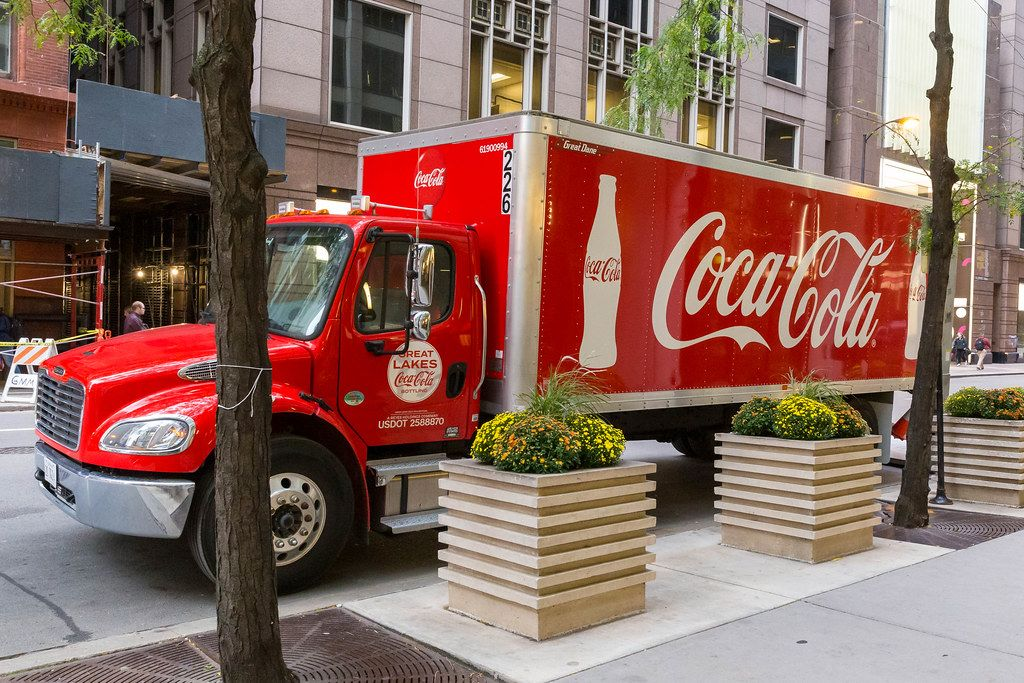 Red Coca Cola truck parked in a street in Downtown Chicago