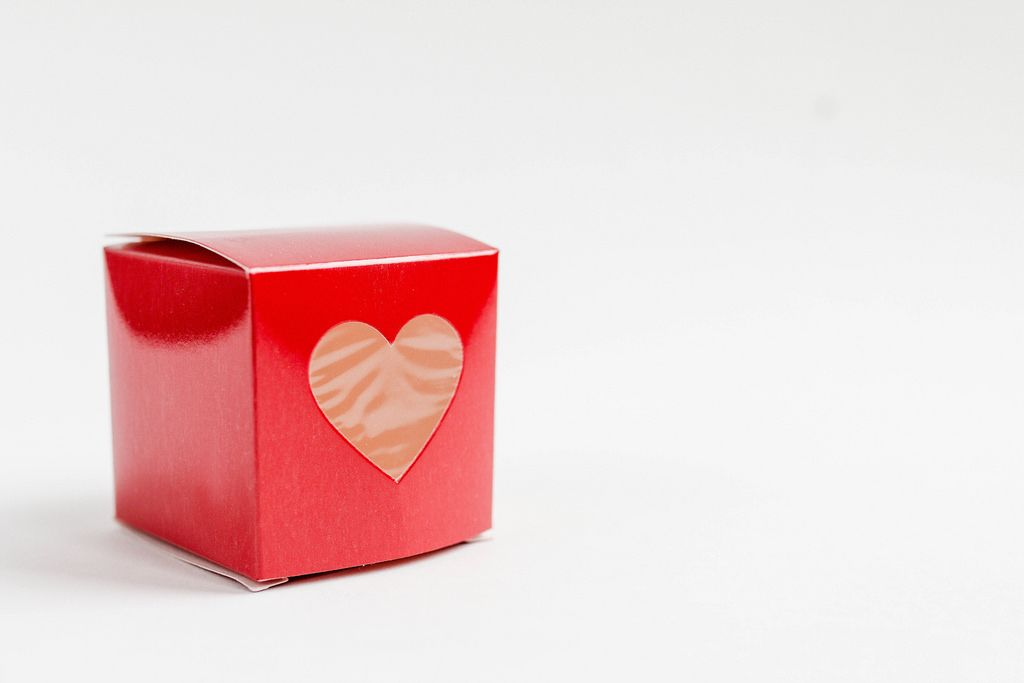 Red square gift box with a heart