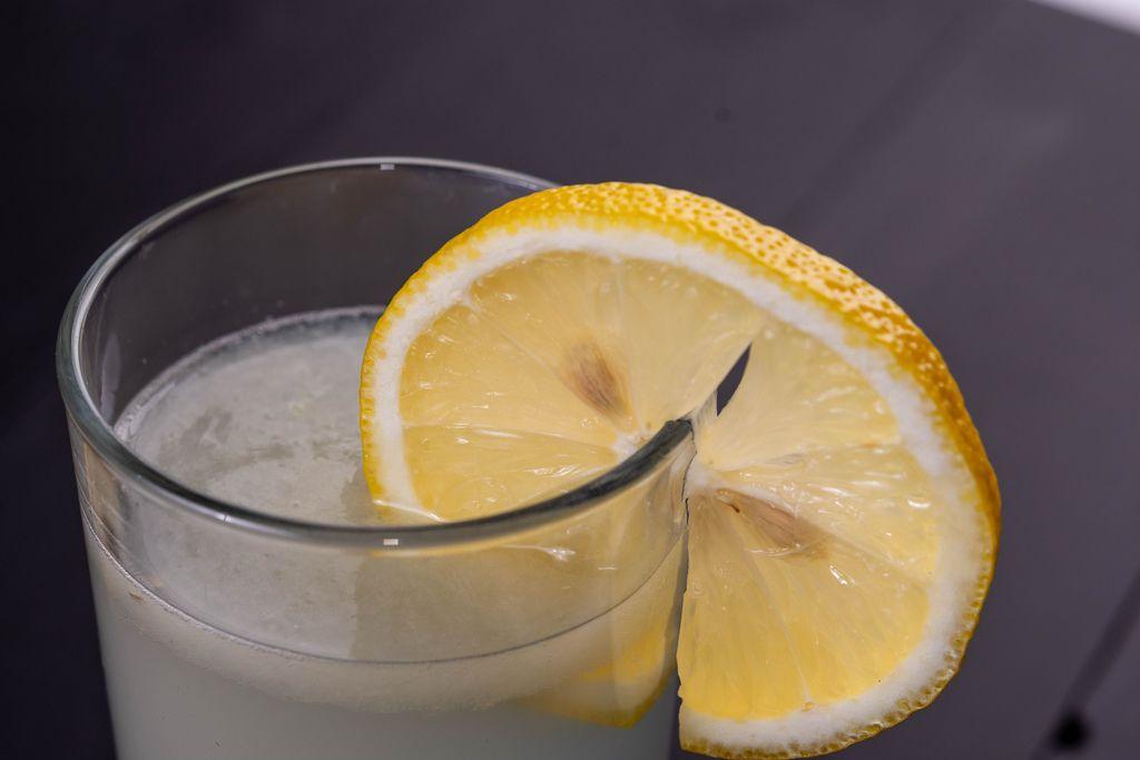 Refreshing Lemonade in the glass with Lemon