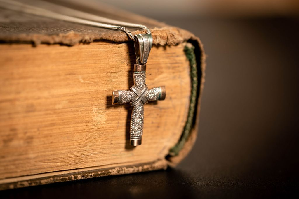Religious old book with cross