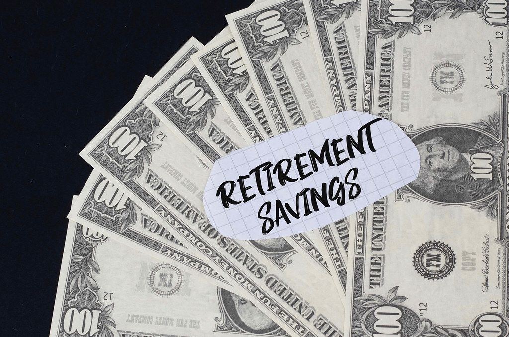 Retirement Savings text and dollar banknotes