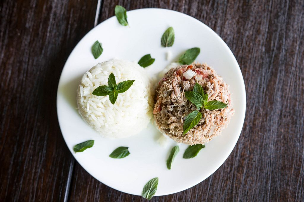 Rice and meat garnished with fresh herbs